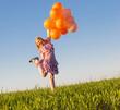 happy girl with orange balloons outdoor