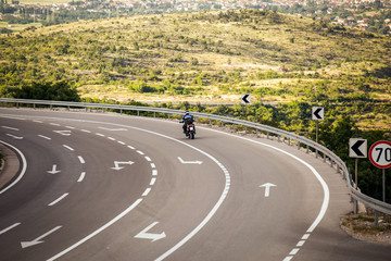 Motorcyclists traveling on the road