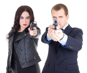 young attractive woman and handsome man posing with gun isolated