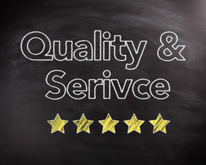 Service and Quality Texts on Chalkboard with Stars