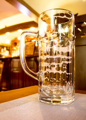 Beer in a glass glass blurred background in bar