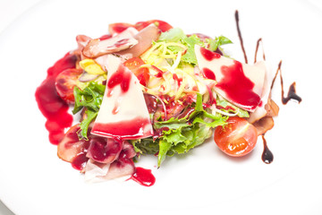 Salad with prosciutto, mix leaf, fruit, cheese and berry sauce