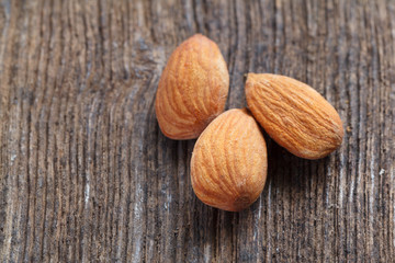 almonds on wood background
