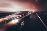 Speeding Compact Car