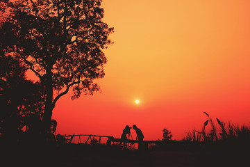 Young couple having fun at sunset time