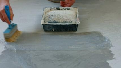 House painter primer concrete floor.