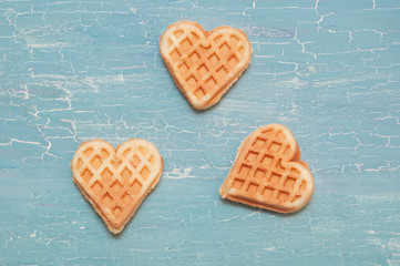 three waffles on a blue background