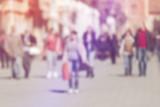 Crowd of People Walking On the Street in Bokeh