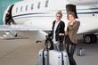 executive business team leaving corporate jet - 80375574