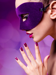 Portrait of a beautiful  woman with purple nails and violet thea