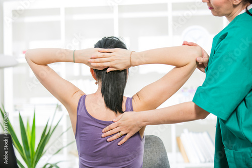 Chiropractor massage the female patient spine and back - 80376902