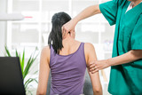 Chiropractor adjusting neck muscles