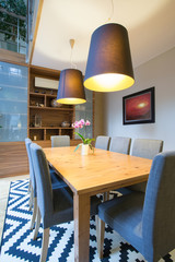 Wooden table inside modern interior