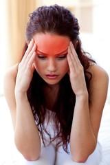 Beautiful girl having a headache in bed