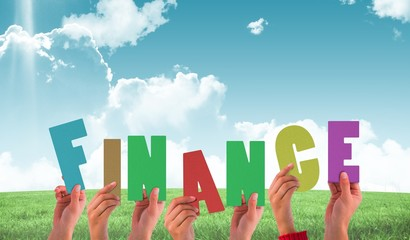 Composite image of hands holding up finance