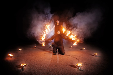 Spectacular fire show with fire dancers