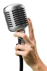 Audience. Female hand holding a single retro microphone against
