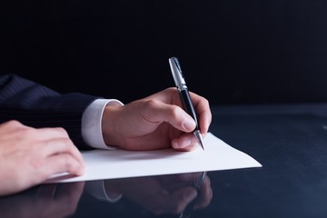 Lawyer. Businessman writing a letter, notes or correspondence or