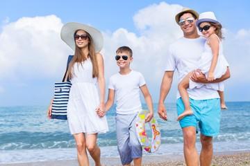 Beach. Happy beautiful family on a Caribbean holiday vacation