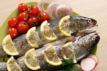 prepared trout fish with lemon and vegetables