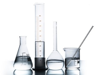 Lab. Laboratory glassware over reflective surface with white