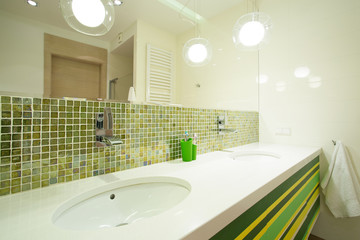 Green tiles in modern bathroom