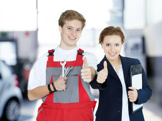 Apprentices for car mechanic and the office show thumbs up