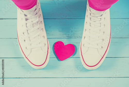 Sneakers with heart on blue wood background, filtered image - 80381398
