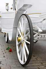 White exclusive wedding carriage with rose
