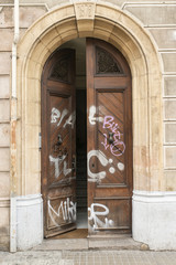 Old open door in the street.