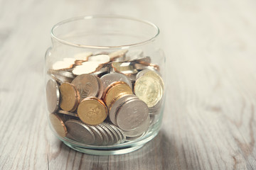 Coins in glass money jar