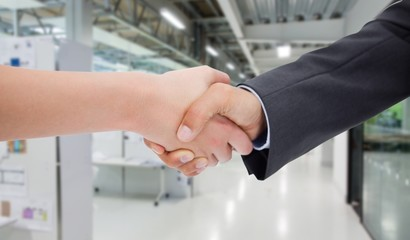 Composite image of close up of a handshake