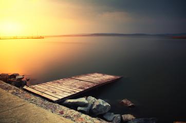 Sunset pier lake