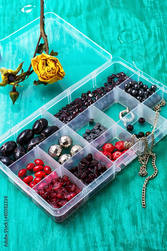 box of beads for needlework on wooden table - 80382334