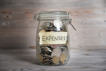Money jar with expenses label.