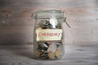 Money jar with emergency label. - 80382972