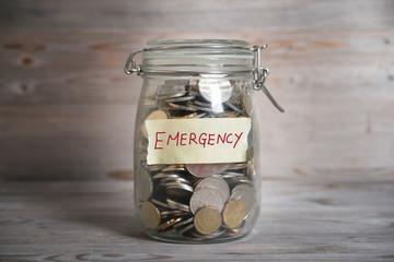 Money jar with emergency label.