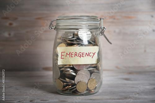 Money jar with emergency label. - 80382972
