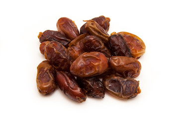 Medjool dates isolated on a white background.