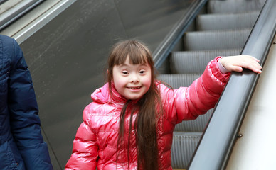 Portrait of beautiful girl on escalator