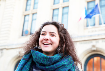 Beautiful student girl on background of Sorbonne