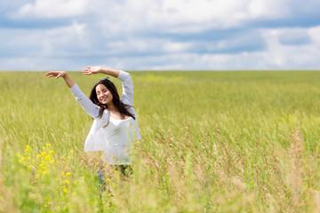 happy girl dancing outside