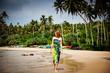 Woman walking on tropical beach