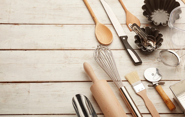 Kitchen baking utensils against white desk