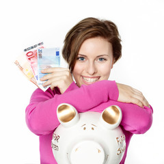 Woman is happy to save money with piggy bank