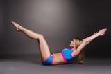 Image of graceful blonde doing pilates exercise