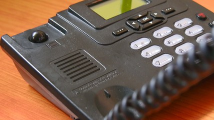 Closeup view of using a telephone, working in the office. 4K.