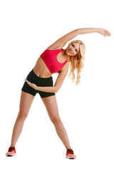 Beautiful young woman doing warm-up exercise