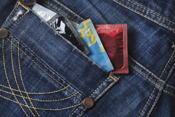 variety of Condoms in the blue jeans pocket
