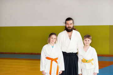 Children standing on tatami with Aikido instructor